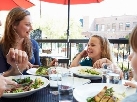 family dining on a restaurant patio