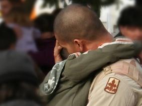 soldier hugging friend