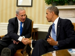 Israeli Prime Minister Benjamin Netanyahu shakes hands with U.S. President Barack Obama in the Oval Office