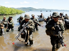 Philippine and U.S. marine soldiers in a joint military exercise in Ulugan bay, Philippines