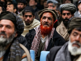 Supporters of Afghan presidential candidate Zalmai Rassoul listen to his speech during the presidential campaign in Kabul March 5, 2014