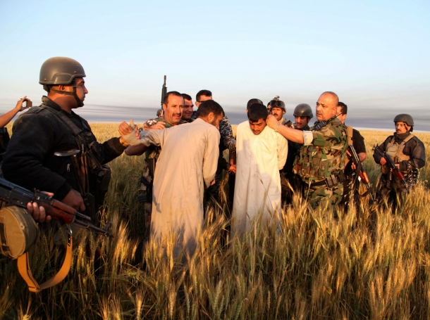 Iraqi security forces arrest suspected militants of the al Qaeda-linked Islamic State in Iraq and the Levant (ISIL) in Hawija on April 24