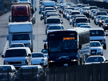 Automobile traffic backs-up as it travels north from San Diego to Los Angeles along Interstate Highway 5 in California