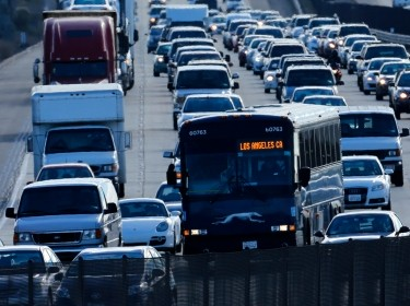 Automobile traffic backs-up as it travels north from San Diego to Los Angeles along Interstate Highway 5 in Cal