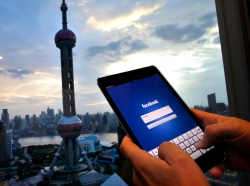A person holding an iPad in Shanghai