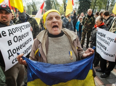 A woman shouts slogans during a protest against separatism in Odessa held outside the Ukrainian Parliame