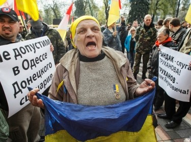 A woman shouts slogans during a protest against separatism in Odessa held outside the Ukrainian Parliament