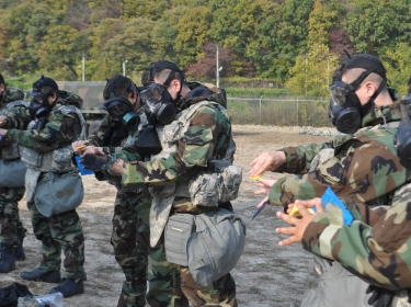 Soldiers practice decontaminating themselves during training on Camp Casey, South Korea
