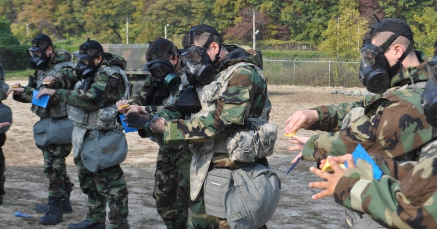U.S. soldiers practice decontaminating themselves during training at Camp Casey, South Korea