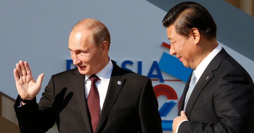 Russia's President Vladimir Putin welcomes China's President Xi Jinping before the first working session of the G20 Summit in near St. Petersburg, Sept. 5, 2013