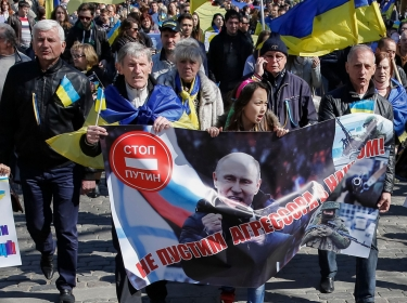 People rally against the annexation of Crimea by Russia, in Odessa, Ukraine. The banner with a portrait of Putin r