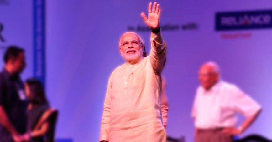 Narendra Modi waves during a youth event organized by India's Citizens for Accountable Governance