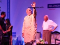 Narendra Modi waves during a youth event organized by India's Citizens for Accountable Governance.