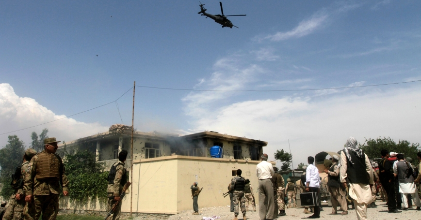 A NATO helicopter flies over the site of a suicide attack in Jalalabad province May 12, 2014. Taliban militants launched a wave of attacks across Afghanistan on Monday, the first day of their declared summer offensive.