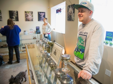 Nate Johnson, managing owner of the Queen Anne Cannabis Club in Seattle, Washington
