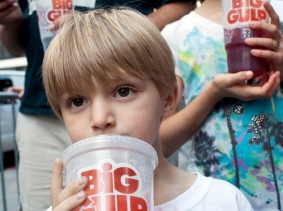 "Benjamin Lesczynski, 8, of New York, takes a sip of a ""Big Gulp"" while protesting the proposed ""soda ban"" suggested by New York City Mayor Michael R. Bloomberg, July 9, 2012"