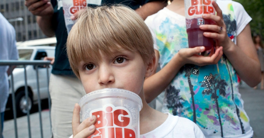 """Benjamin Lesczynski, 8, of New York, takes a sip of a """"Big Gulp"""" while protesting the proposed """"soda ban"""" suggested by New York City Mayor Michael R. Bloomberg, July 9, 2012"""