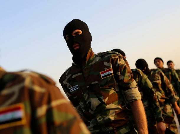 Mehdi Army fighters loyal to a Shi'ite cleric march during a military-style training in Najaf, June 18, 2014