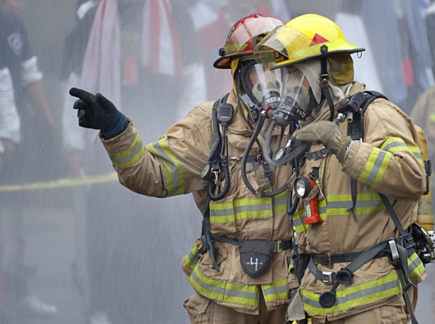 two firemen responding to an emergency