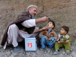 A child receives polio vaccination during an anti-polio campaign on the outskirts of Jalalabad, Afghanistan