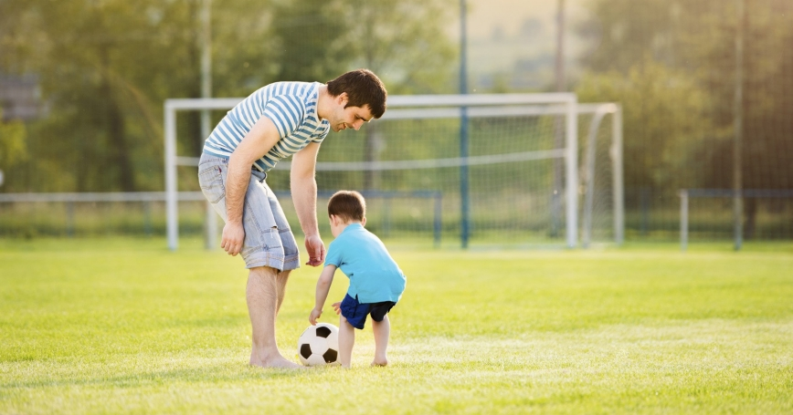 father and son playing with a ball