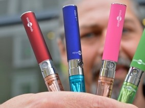 Gabor Kovacs of 'smoke no smoke' displays e-cigarettes that his shop sells at Camden in London