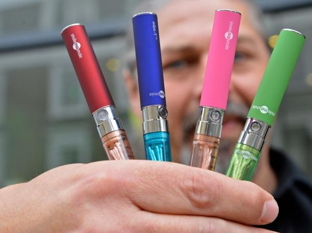 Gabor Kovacs of 'smoke no smoke' displays e-cigarettes that his shop sells at Camden in London