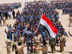 Volunteers, who have joined Iraqi security forces to fight against militants from the radical Islamic State of Iraq and the Levant (ISIL), gather in Najaf, June 18, 2014
