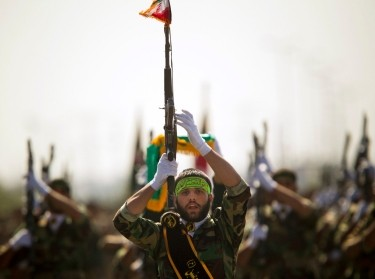Members of Iran's Basij militia march during a parade to commemorate the anniversary of the Iran-Iraq war, September 22, 2010