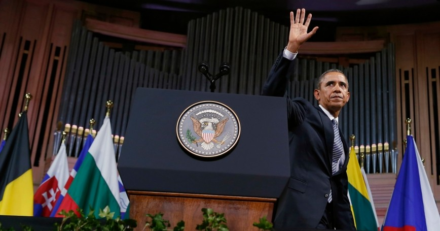 U.S. President Barack Obama waves after delivering a speech at Palais des Beaux-Arts in Brussels, Belgium March 26, 2014