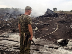 A pro-Russian separatist at the crash site of a Malaysia Airlines Boeing 777 in Ukraine's Donetsk region, July 17, 2014