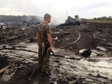 A pro-Russian separatist at the crash site of a Malay