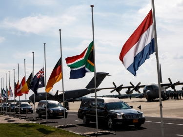 A convoy of hearses bearing the remains of the victims of Malaysia Airlines Flight 17 leaves Eindhoven airport in the Netherlands, Jul