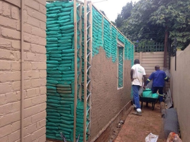 South African men create a sandbag build