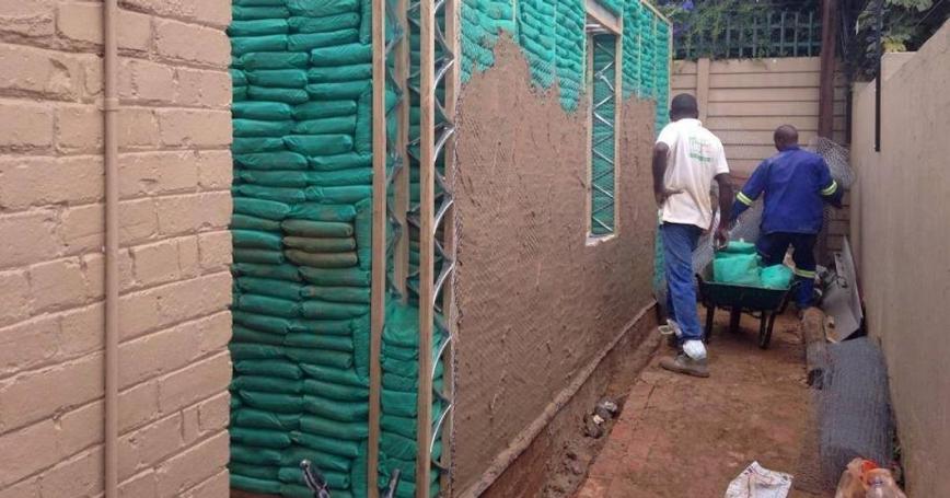 South African men create a sandbag building for EcoSteps
