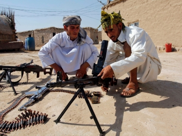 Shi'ite volunteers, who've joined the Iraqi army against militants from the radical Islamic State, take part in weapons training, July 18, 2014