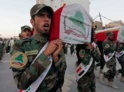 Members of Shi'ite group Asaib Ahl al-Haq carry coffins of fighters killed in clashes with the Islamic State of Iraq and the Levant (ISIL), July 7, 2014