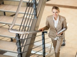 A woman at work taking the stairs
