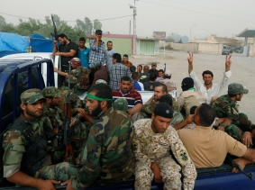 """Followers of radical cleric Muqtada al-Sadr, who fought U.S. troops under the banner of the Mehdi Army during the 2003-11 occupation, have returned as Sadr's new """"Peace Brigades"""""""