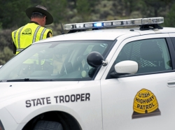 Utah Highway Patrol police car and trooper