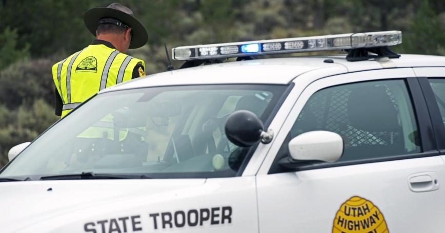 Utah Highway Patrol police car and trooper