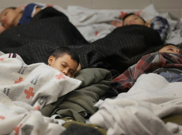Detainees sleep in a holding cell at a U.S. Customs and Border Protection processing facility, June 18, 2014