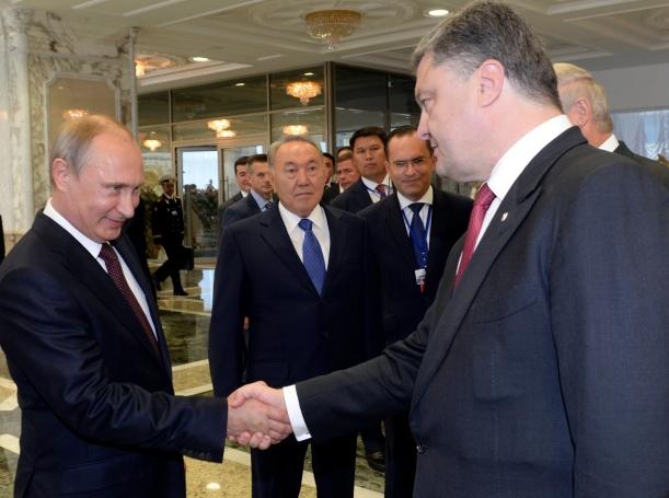 Russian President Vladimir Putin shakes hands with his Ukrainian counterpart, Petro Poroshenko, in Minsk, August 26, 2014