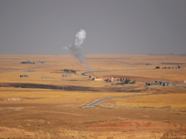 Smoke rises during clashes between Kurdish pesh