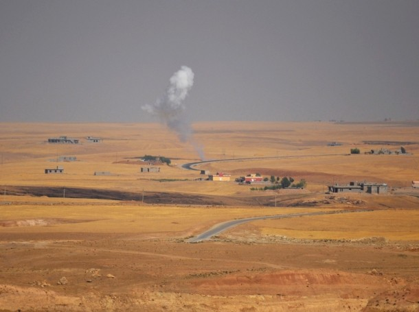 Smoke rises during clashes between Kurdish peshmerga troops and militants of the Islamic State, formerly known as ISIL, on the outskirts of Sinjar, August 5, 2014