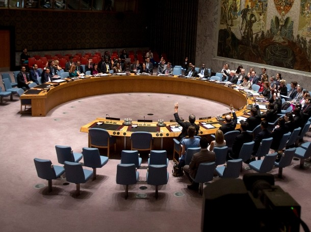 Members of the United Nations Security Council vote on a resolution about the ongoing crisis in Iraq at UN headquarters in New York