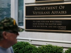 A man walks past the headquarters building at the Department of Veterans Affairs in Washington, DC, May 23, 2014