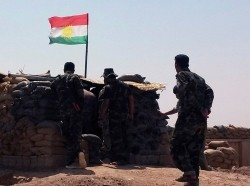 Members of Kurdish Peshmerga force stand guard at Sulaiman Pek front line, August 31, 2014. Iraqi security forces backed by Shi'ite militias on Sunday broke the two-month siege of Amerli by Islamic State militants.
