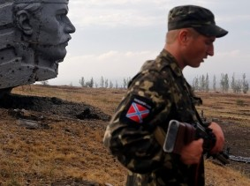 A Pro-Russian separatist stands near the damaged war memorial at Savur-Mohyla, east of the city of Donetsk, Ukraine