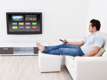 Man in living room with smart television